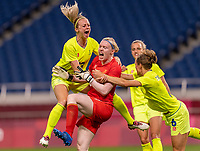 TOKYO, JAPAN - JULY 24: Amanda Ilestedt #13 celebrates a penalty kick save with Hedvig Lindahl #1 of Sweden during a game between Australia and Sweden at Saitama Stadium on July 24, 2021 in Tokyo, Japan.
