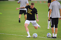 WASHINGTON, DC - AUGUST 25: Alexander Buttner #28 of New England Revolution warming up during a game between New England Revolution and D.C. United at Audi Field on August 25, 2020 in Washington, DC.