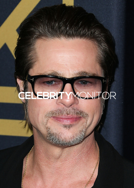 HOLLYWOOD, LOS ANGELES, CA, USA - DECEMBER 15: Brad Pitt arrives at the Los Angeles Premiere Of Universal Pictures' 'Unbroken' held at the Dolby Theatre on December 15, 2014 in Hollywood, Los Angeles, California, United States. (Photo by Xavier Collin/Celebrity Monitor)