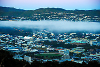 Wellington city, with the Basin reserve lower middle of image, from Mount Victoria at 6.30am, Friday during Level 3 lockdown for the COVID-19 pandemic in Wellington, New Zealand on Friday, 3 September 2021.
