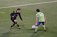 COLUMBUS, OH - DECEMBER 12: Lucas Zelarayan #10 of the Columbus Crew and Nicolas Lodeiro #10 of the Seattle Sounders FC challenge for the ball during a game between Seattle Sounders FC and Columbus Crew at MAPFRE Stadium on December 12, 2020 in Columbus, Ohio.