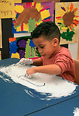MR/ Schenectady, New York.Yates Arts-in-Education Magnet School / Pre-Kindergarten.Student uses shaving cream as art and sensory experience activity. (Boy: 4, African-American)..MR:Mar7      FC#:20910-00512.scan from slide.© Ellen B. Senisi