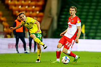 3rd November 2020; Carrow Road, Norwich, Norfolk, England, English Football League Championship Football, Norwich versus Millwall; Oliver Skipp of Norwich City passes the ball away from Jon Daoi Boovarsson of Millwall