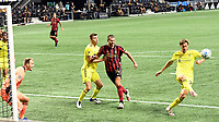 ATLANTA, GA - AUGUST 22: Walker Zimmerman #25 clears a crossed ball intended for Adam Jahn #14 during a game between Nashville SC and Atlanta United FC at Mercedes-Benz Stadium on August 22, 2020 in Atlanta, Georgia.