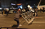 Protesters try to set a barricade at the University square, Bucharest, Romania.  January 19th 2012, thousands of Romanians rallied  for 7th day at University square  to protest against austerity measures, calling for president Basescu and the government to resign.