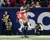 ATLANTA, GA - DECEMBER 7: DJ Daniel #14 of the Georgia Bulldogs knocks the pass away from Terrace Marshall Jr. #6 of the LSU Tigers during a game between Georgia Bulldogs and LSU Tigers at Mercedes Benz Stadium on December 7, 2019 in Atlanta, Georgia.