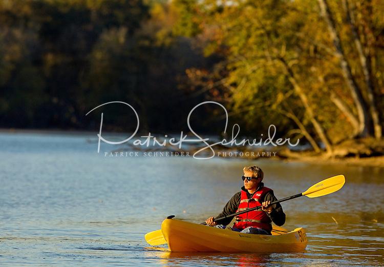 A man (model) kayaks along the Catawba River as he participates in a Micro Brews Cruise outing at the US National Whitewater Center in Charlotte, NC. The USNWC, an ultimate adventure playground for outdoor enthusiasts, offers both water and land sports. Micro Brews Cruise offers flatwater kayaking, fireside dinner and craft beer tastings on select nights.