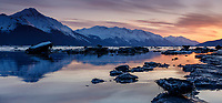 Spring Landscape of the sunset over ice bergs and the waters of Turnagain Arm with the Kenai Mountains in the background south of Anchorage. <br /> <br /> <br /> Photo by Jeff Schultz/  (C) 2020  ALL RIGHTS RESERVED