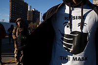 """NEW YORK, NEW YORK - DECEMBER 06: A man wears a T-Shirt  as he takes part during a protest to resist government mandated Covid-19 restrictions on December 6, 2020 in Brooklyn, New York. At a """"Medical Freedom"""" rally in Brooklyn organized by the group Liberate NY and others who resist government mandated Covid-19 restrictions organizers denounces government requirements to use masks and the anticipated Covid vaccine.(Photo by Stephen Ferry/VIEWpress)"""