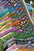 Colorful dresses on hangers in store (Licence this image exclusively with Getty: http://www.gettyimages.com/detail/83154211 )