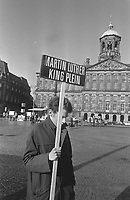 Commemoration of the murder of Rev. Martin Luther King on the Dam, Amsterdam, April 4, 1969<br /> <br /> He was murdered one year earlier , in 1968<br /> <br /> Photographer Evers, Joost / Anefo