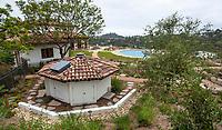 Cistern water storage under garden shed in California garden for water harvest; Urban Water Group design