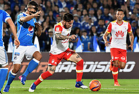 BOGOTA - COLOMBIA -19 -03-2017: Andres Cadavid (Izq) jugador de Millonarios disputa el balón con Jonathan Gomez (Der) jugador de Independiente Santa Fe durante partido  partido por la fecha 10 de la Liga Aguila I 2017 jugado en el estadio Nemesio Camacho El Campin de la ciudad de Bogota./ Andres Cadavid (L) player of Millonarios fights for the ball with Jonathan Gomez (R) player of Independiente Santa Fe during match for the date 10 of the Liga Aguila I 2017 played at the Nemesio Camacho El Campin Stadium in Bogota city. Photo: VizzorImage / Gabriel Aponte / Staff.
