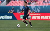 DENVER, CO - JUNE 3: Antonee Robinson #5 of the United States looks for an open man downfield during a game between Honduras and USMNT at EMPOWER FIELD AT MILE HIGH on June 3, 2021 in Denver, Colorado.