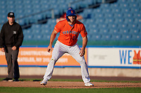 Syracuse Mets Tim Tebow (15) leads off first base during an International League game against the Charlotte Knights on June 11, 2019 at NBT Bank Stadium in Syracuse, New York.  Syracuse defeated Charlotte 15-8.  (Mike Janes/Four Seam Images)