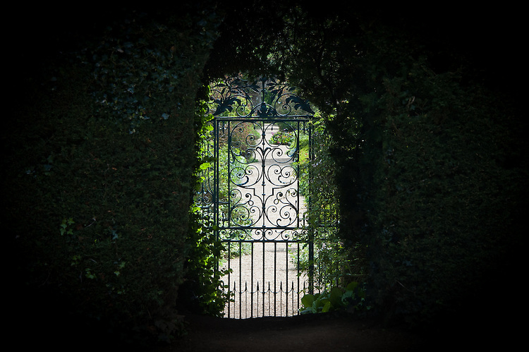 Door through the yew hedge into the walled garden, Rousham House.