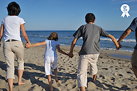 Family holding hands running away on beach (Licence this image exclusively with Getty: http://www.gettyimages.com/detail/83154261 )