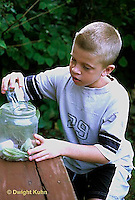 HE09-018z   Milkweed bug - boy collecting milkweed bugs - Lygaeus kalmii