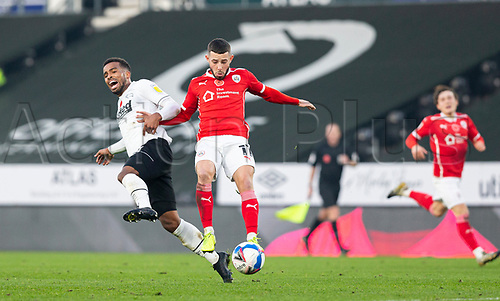 7th November 2020; Pride Park, Derby, East Midlands; English Football League Championship Football, Derby County versus Barnsley; Nathan Byrne of Derby County fouls Conor Chaplin of Barnsley leading to him receiving a yellow card from Referee Leigh Doughty