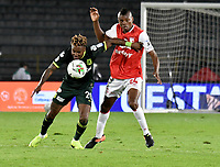 BOGOTA-COLOMBIA, 08-03-2020: Jeison Palacios de Independiente Santa Fe y Gustavo Torres de Atletico Nacional disputan el balon durante partido entre Independiente Santa Fe y Atletico Nacional de la fecha 8 por la Liga BetPlay DIMAYOR 2020 jugado en el estadio Nemesio Camacho El Campín de la ciudad de Bogota. / Jeison Palacios of Independiente Santa Fe and Gustavo Torres of Atletico Nacional vie for the ball during a match of the 8th date between Independiente Santa Fe and Atletico Nacional, for the BetPlay DIMAYOR I Leguaje 2020 at the Nemesio Camacho El Campin Stadium in Bogota city. / Photo: VizzorImage / Luis Ramirez / Staff.
