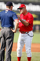 August 2, 2009:  Manager Mark DeJohn of the Batavia Muckdogs argues a call with base umpire Tim Rosso during a game at Dwyer Stadium in Batavia, NY.  The Muckdogs are the Short-Season Class-A affiliate of the St. Louis Cardinals.  Photo By Mike Janes/Four Seam Images