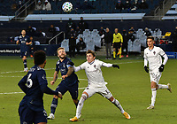 KANSAS CITY, KS - OCTOBER 24: #7 Johnny Russell of Sporting Kansas City and #13 Sam Vines of the Colorado Rapids battle for the ball during the second half during a game between Colorado Rapids and Sporting Kansas City at Children's Mercy Park on October 24, 2020 in Kansas City, Kansas.