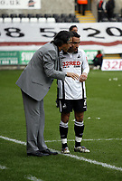 ATTENTION SPORTS PICTURE DESK<br /> Pictured: Paulo Sousa Manager of Swansea City speak to Leon Britton of Swansea City<br /> Re: Coca Cola Championship, Swansea City Football Club v Cardiff City FC at the Liberty Stadium, Swansea, south Wales. Saturday 07 November 2009