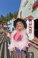 In period dress, Dolly greets visitors on the famous Creek Street in downtown Ketchikan, southeast, Alaska.