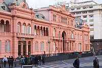 The Casa Rosada, pink house, or Casa Gobierno, housing the government on Plaza de Mayo May square. Well barricaded with riot fences to prevent attack Buenos Aires Argentina, South America