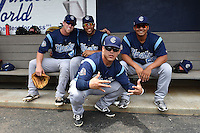 Corpus Christi Hooks second baseman Nolan Fontana (4), outfielder Leo Heras (8 - front) and pitchers Jorge De Leon (43) and Luis Cruz (55) in the dugout before a game against the NW Arkansas Naturals on May 26, 2014 at Arvest Ballpark in Springdale, Arkansas.  NW Arkansas defeated Corpus Christi 5-3.  (Mike Janes/Four Seam Images)