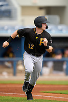 FCL Pirates Black Henry Davis (32) runs to first base in the top of the first inning during a game against the FCL Rays on August 3, 2021 at Charlotte Sports Park in Port Charlotte, Florida.  Davis was making his professional debut after being selected first overall in the MLB Draft out of Louisville by the Pittsburgh Pirates.  (Mike Janes/Four Seam Images)