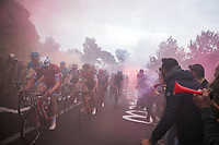 peloton led by former winner Alexander Kristoff (NOR/Katusha) up the smoke & tifosi packed Capo Berta (38 km's before the finish) with later winner Michal Kwiatkowski (POL/SKY) emerging 2/3 rows down<br /> <br /> 108th Milano - Sanremo 2017