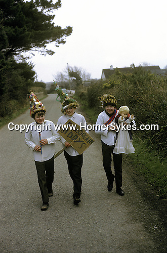 Biddy Boys 1970s. Killorglin  Co Kerry Ireland. February 2nd festival to celebrate the Celtic Saint Brigid. A doll - St Bridgid - is taken from house to house by young Biddy Boys who bring good luck and good fortune to the household.