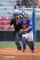 Kingsport Mets catcher Dionis Rodriguez (12) chases after a foul pop fly during the game against the Elizabethton Twins at Hunter Wright Stadium on July 8, 2015 in Kingsport, Tennessee.  The Mets defeated the Twins 8-2. (Brian Westerholt/Four Seam Images)
