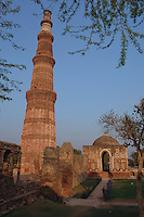 The tower Qutub Minar built of red sandstone is the tallest brick minaret in the world, and an important example of Indo-Islamic Architecture. The tower is in the Qutb complex at Mehrauli in South Delhi, India, India.  Next to the Minar is the Quwwat-ul-Islam (`Might of Islam') Mosque, one of the earliest examples of Islamic architecture in India