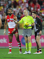 Referee Mathew Nichols prepares to start play during the Australian Rules Football ANZAC Day match between St Kilda Saints and Sydney Swans at Westpac Stadium, Wellington, New Zealand on Thursday, 24 May 2013. Photo: Dave Lintott / lintottphoto.co.nz