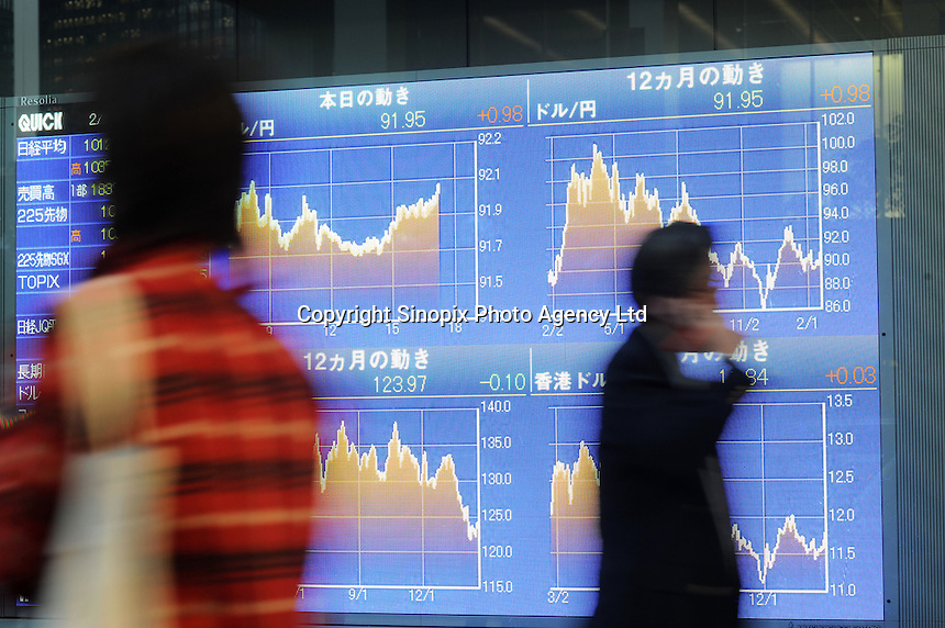 People pass a Stock Exchange Screen board in Tokyo, Japan. Japan's stock falls mirrored similar activity in the stock market's of other nations, with Hong Kong, Singapore and South Korea also seeing drops..