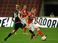 20131009 - LIEGE , BELGIUM : Standard's Julie Biesmans pictured in front of Glasgow's Leanne Ross (16) during the female soccer match between STANDARD Femina de Liege and GLASGOW City LFC , in the 1/16 final ( round of 32 ) first leg in the UEFA Women's Champions League 2013 in stade Maurice Dufrasne - Sclessin in Liege. Wednesday 9 October 2013. PHOTO DAVID CATRY