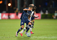 LAKE BUENA VISTA, FL - AUGUST 01: Jesús Medina #19 of New York City FC is pressured by Diego Chará #21 of the Portland Timbers during a game between Portland Timbers and New York City FC at ESPN Wide World of Sports on August 01, 2020 in Lake Buena Vista, Florida.