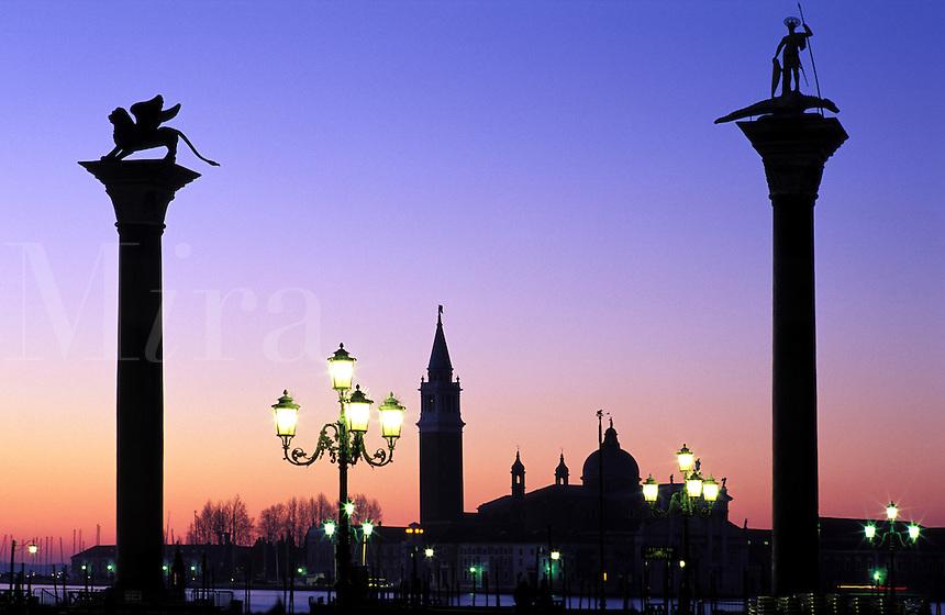 Italy, Venice. San Giorgio Maggiore and Piazzetta San Marco at dawnColumns of St.Theadore and Winged Lion of St. Mark'