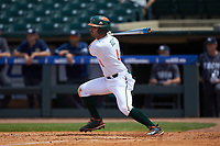 Johnny Ruiz (4) of the Miami Hurricanes follows through on his swing against the Georgia Tech Yellow Jackets during game one of the 2017 ACC Baseball Championship at Louisville Slugger Field on May 23, 2017 in Louisville, Kentucky. The Hurricanes walked-off the Yellow Jackets 6-5 in 13 innings. (Brian Westerholt/Four Seam Images)