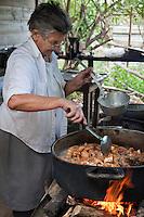 Cuba, Pinar del Rio Region, Viñales (Vinales) Area.  Señora Montecinos Frying Pork Rinds for Field Workers' Lunch, Montecinos Tobacco Farm.