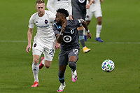 ST PAUL, MN - NOVEMBER 4: Romain Metanire #19 of Minnesota United FC chases down the ball during a game between Chicago Fire and Minnesota United FC at Allianz Field on November 4, 2020 in St Paul, Minnesota.