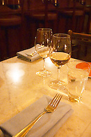 A table set for two with wine glasses and linen napkins and forks at the gastronomic restaurant Eriks Bakficka på Östermalm Stockholm, Sweden, Sverige, Europe