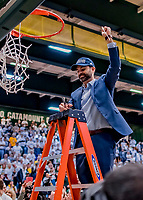 16 March 2019: University of Vermont Catamount Assistant Director of Athletics, Sport Psychology and Counseling, cuts himself a piece of net after a victory over the UMBC Retrievers in the America East Championship Game at Patrick Gymnasium in Burlington, Vermont. The Catamounts defeated the Retrievers 66-49, avenging their loss against the same team in last years' Championship Game. Mandatory Credit: Ed Wolfstein Photo *** RAW (NEF) Image File Available ***