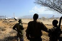 KENYA, Marsabit, airstrip of Lake Turkana Wind Power Project, Vestas will supply in the next four years wind turbines and rotor blades for the 310 MW project, the largest windfarm in africa, security guards with gun / KENIA, Marsabit, Landepiste des Lake Turkana Wind Power Projekt, hier werden in den naechsten 4 Jahren Wind Turbinen und Rotorblaetter des Herstellers Vestas fuer das 310 MW Projekt aufgebaut