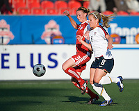 25 May 09:  USA National forward Amy Rodriguez #8 and Canadian National defender Melanie Booth #3 in action in an International Friendly soccer game between the US Women's Team and the Canadian Women's Team at BMO Field in Toronto..The US Women's Team won 4-0.