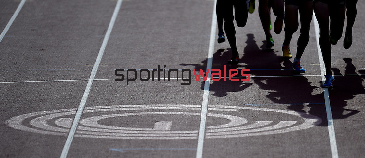 Competitors in the men's 1500m round 1 - head 1 run past the Glasgow 2014 Commonwealth Games logo printed on the race track<br /> <br /> Photographer Chris Vaughan/Sportingwales<br /> <br /> 20th Commonwealth Games - Day 9 - Friday 1st August 2014 - Athletics - Hampden Park - Glasgow - UK