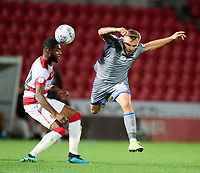 Lincoln City's Harry Anderson battles with Doncaster Rovers' Cameron John<br /> <br /> Photographer Andrew Vaughan/CameraSport<br /> <br /> EFL Leasing.com Trophy - Northern Section - Group H - Doncaster Rovers v Lincoln City - Tuesday 3rd September 2019 - Keepmoat Stadium - Doncaster<br />  <br /> World Copyright © 2018 CameraSport. All rights reserved. 43 Linden Ave. Countesthorpe. Leicester. England. LE8 5PG - Tel: +44 (0) 116 277 4147 - admin@camerasport.com - www.camerasport.com