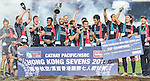 New Zealand players celebrate with the trophy after winning the Cup Final during the Cathay Pacific / HSBC Hong Kong Sevens at the Hong Kong Stadium on 30 March 2014 in Hong Kong, China. Photo by Victor Fraile / Power Sport Images